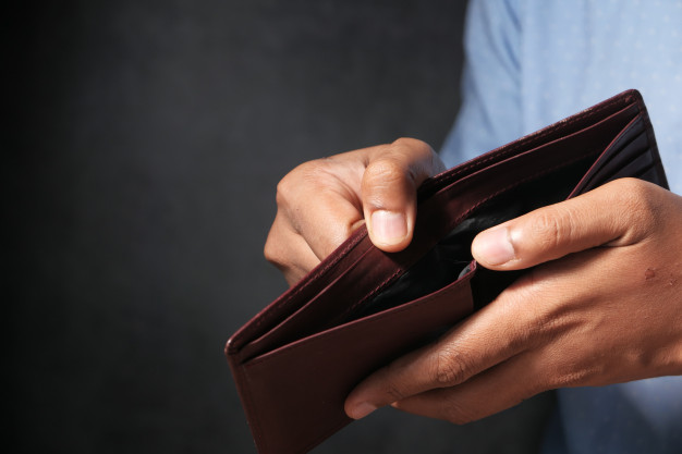man-hand-open-empty-wallet-with-copy-space_260672-354